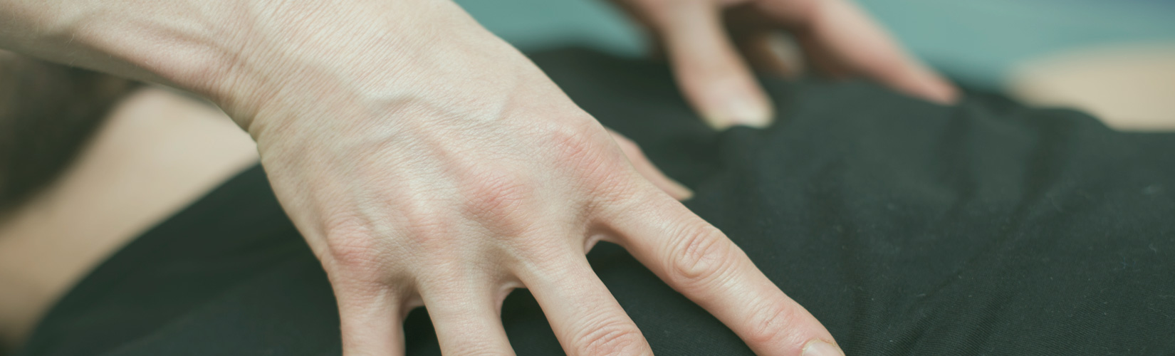 hands close up acupressure back
