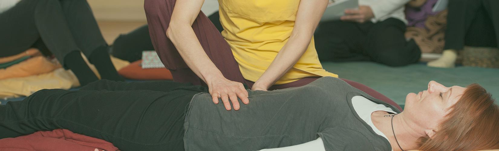 shiatsu treatment floor hands stomach